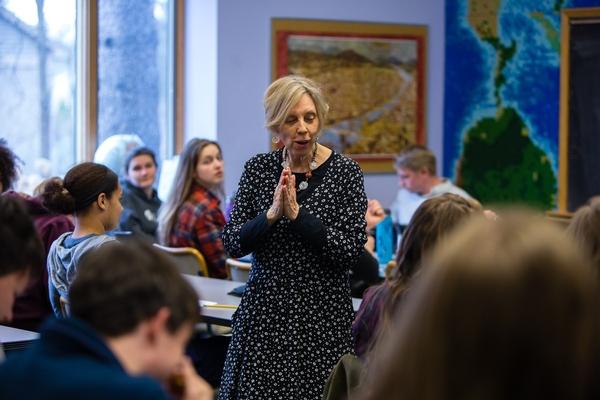 High School teacher presenting to class