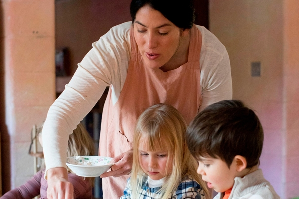 Early Childhood Teacher baking with students