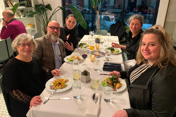 Group of Parents and Teachers at Dinner Event