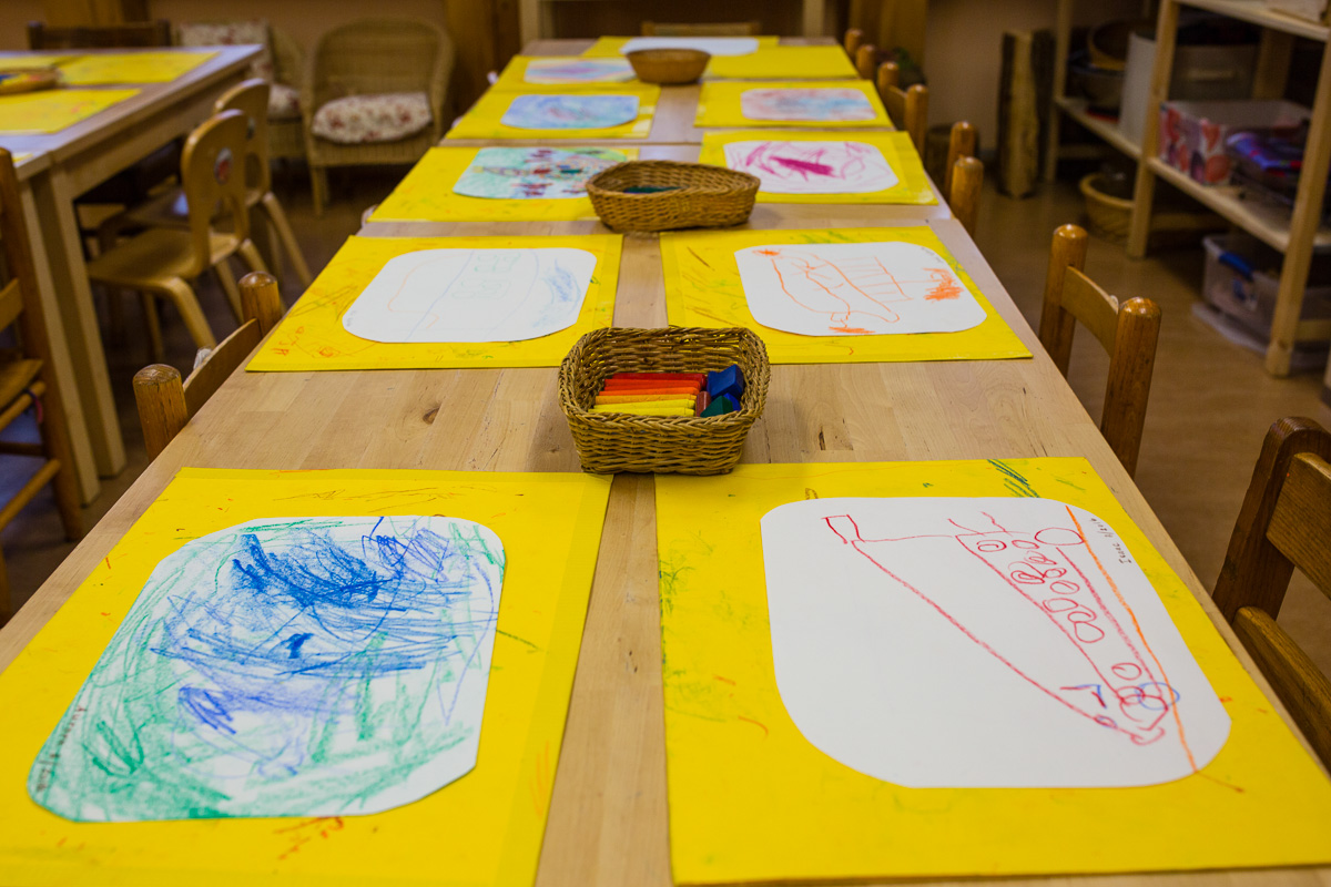 Table with Early Childhood Drawing Paper and Crayons