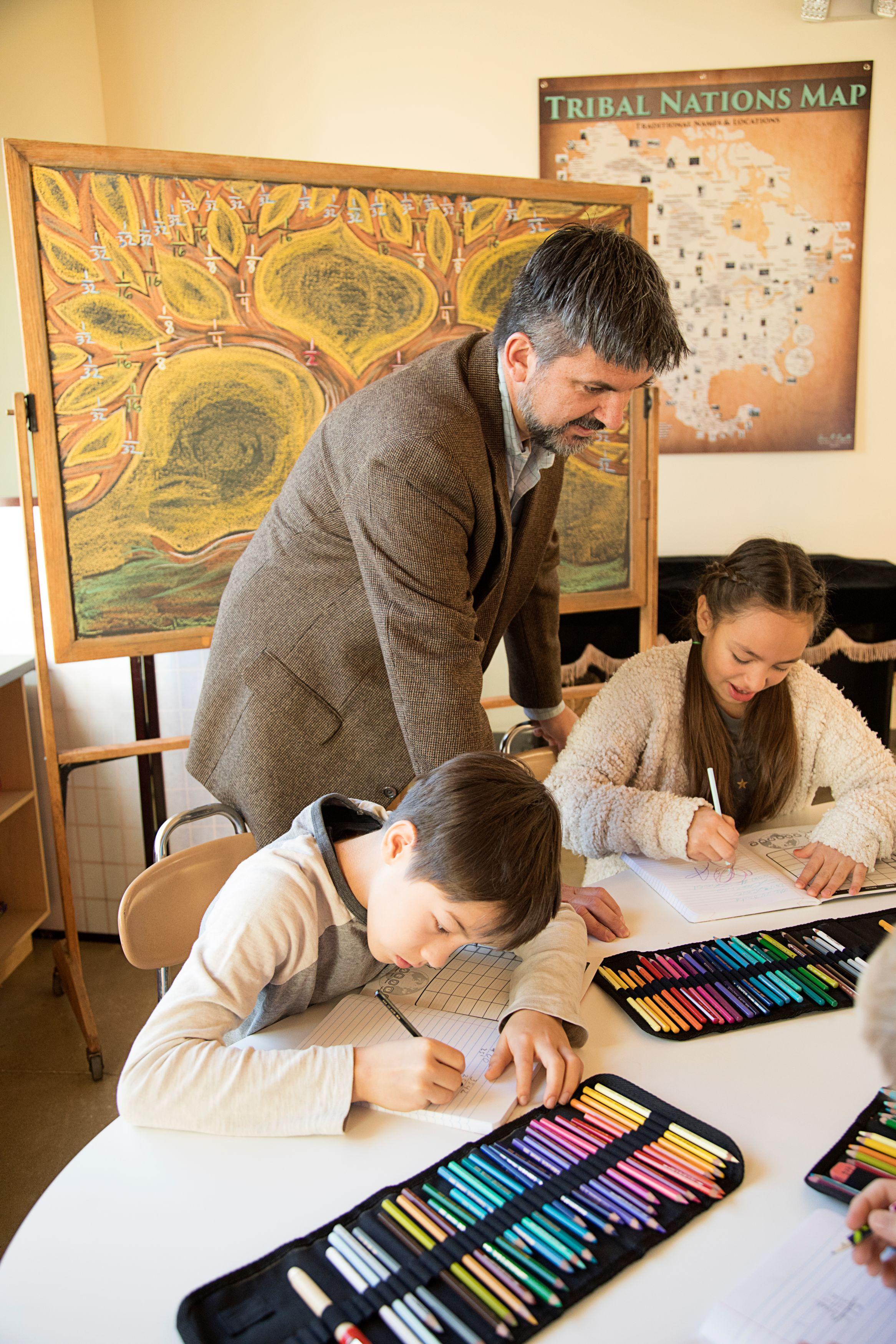 Teacher with Boy and Girl