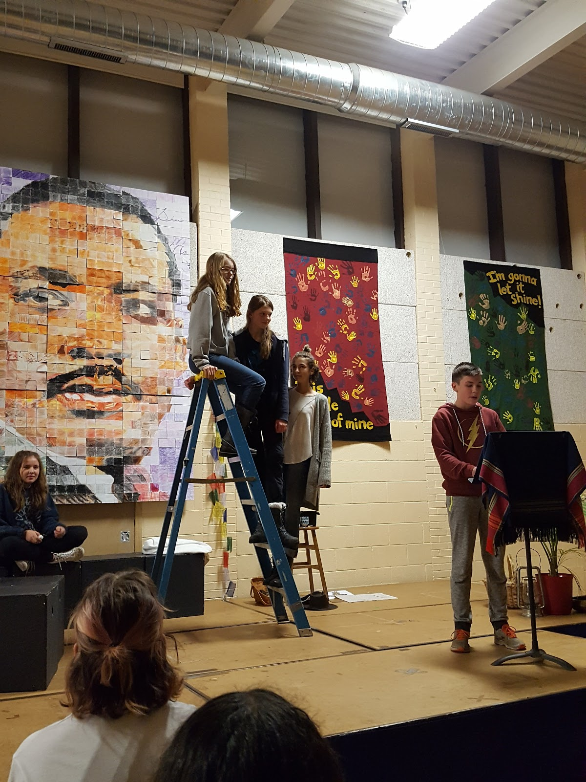 Students Presenting with MLK Mosaic in Background