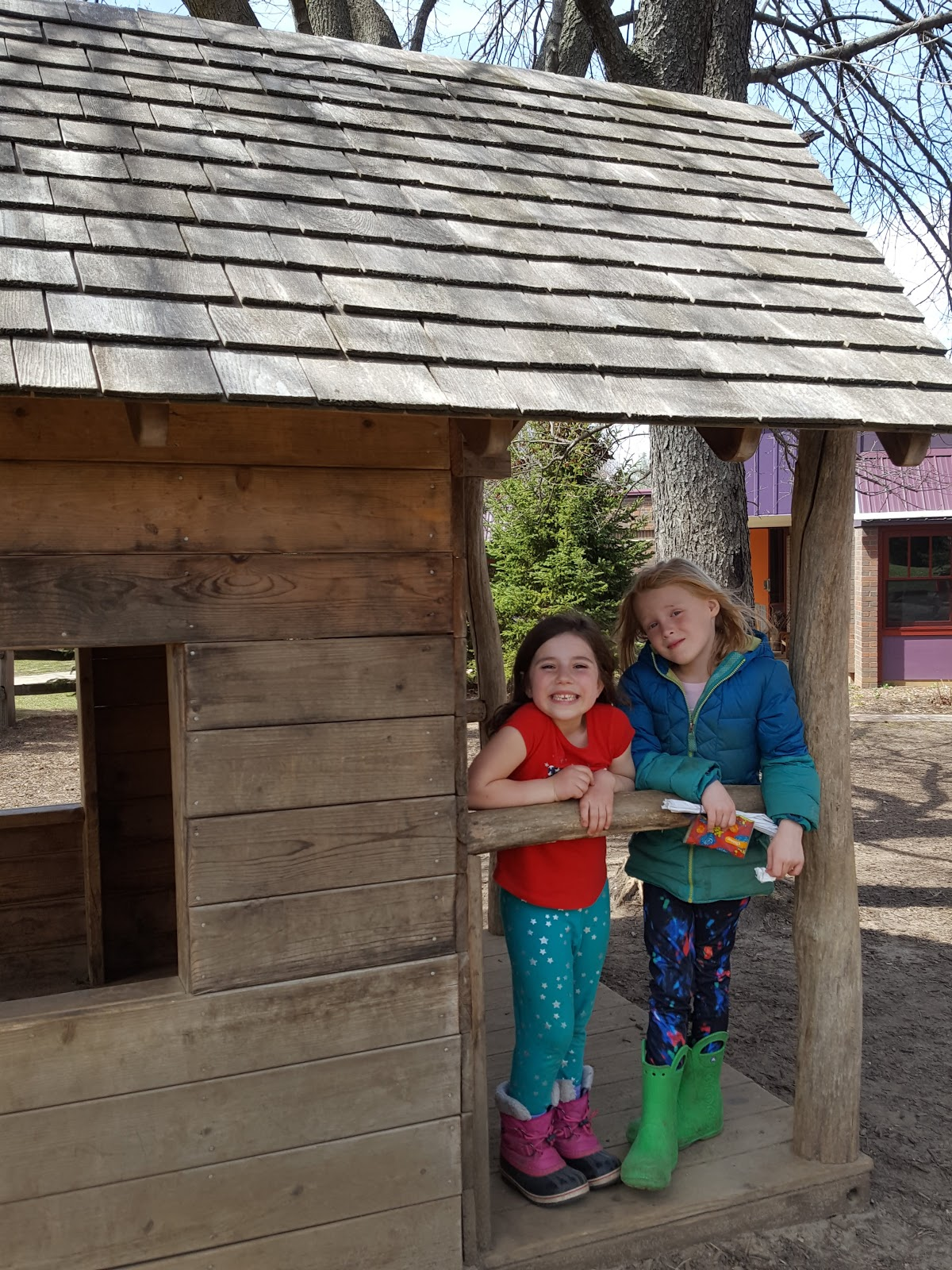 Two girls in playhouse