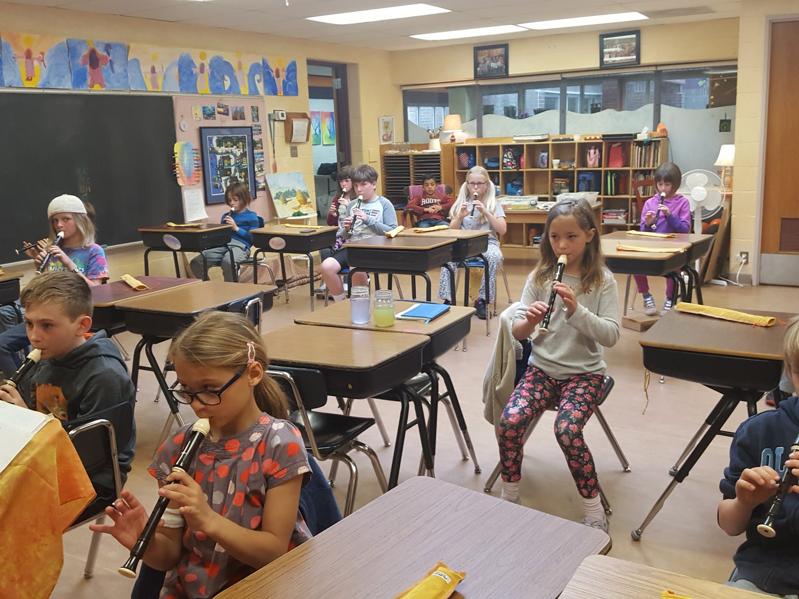 Second grade class playing recorder
