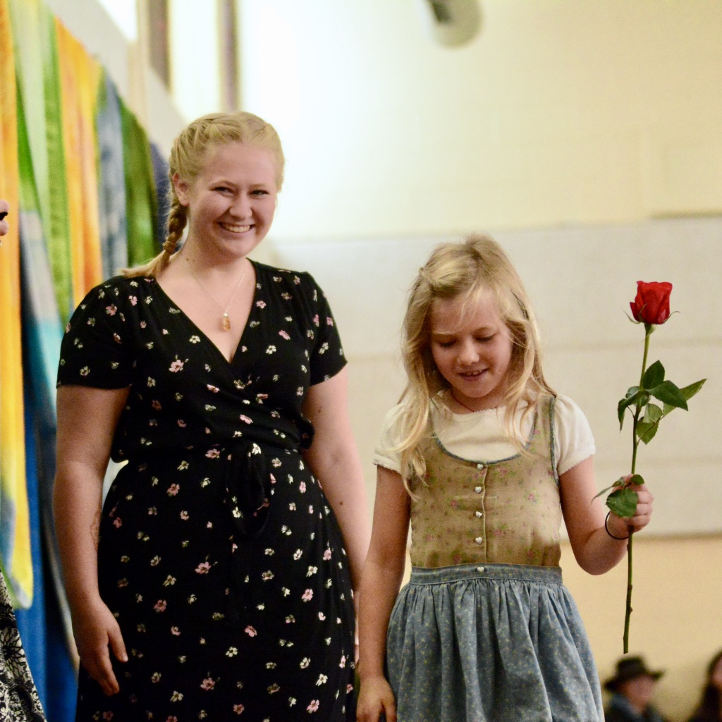 Teen and Child holding Rose