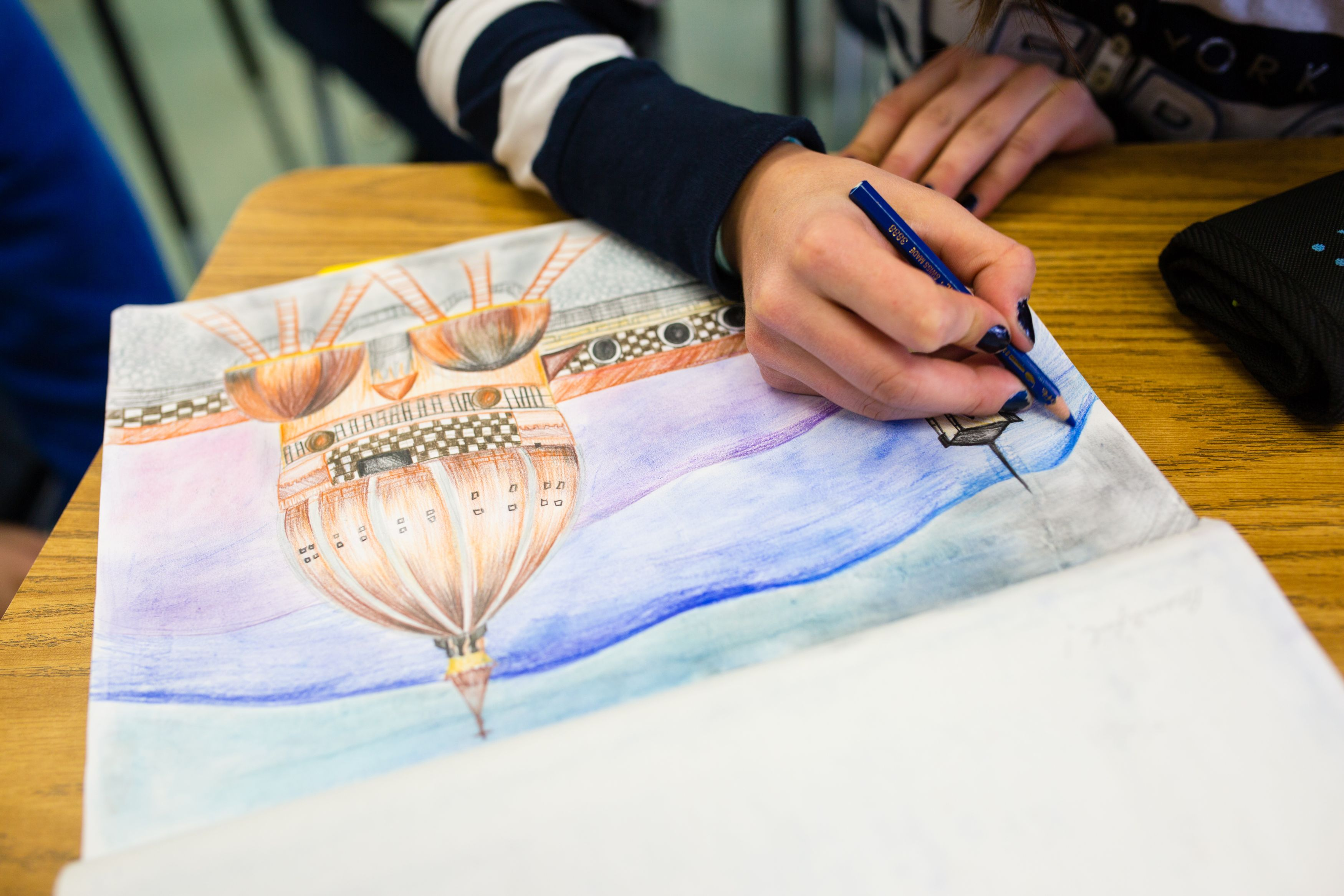 Student Working on Textbook Drawing