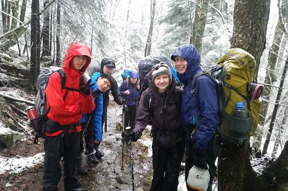 Group of students hiking in snow