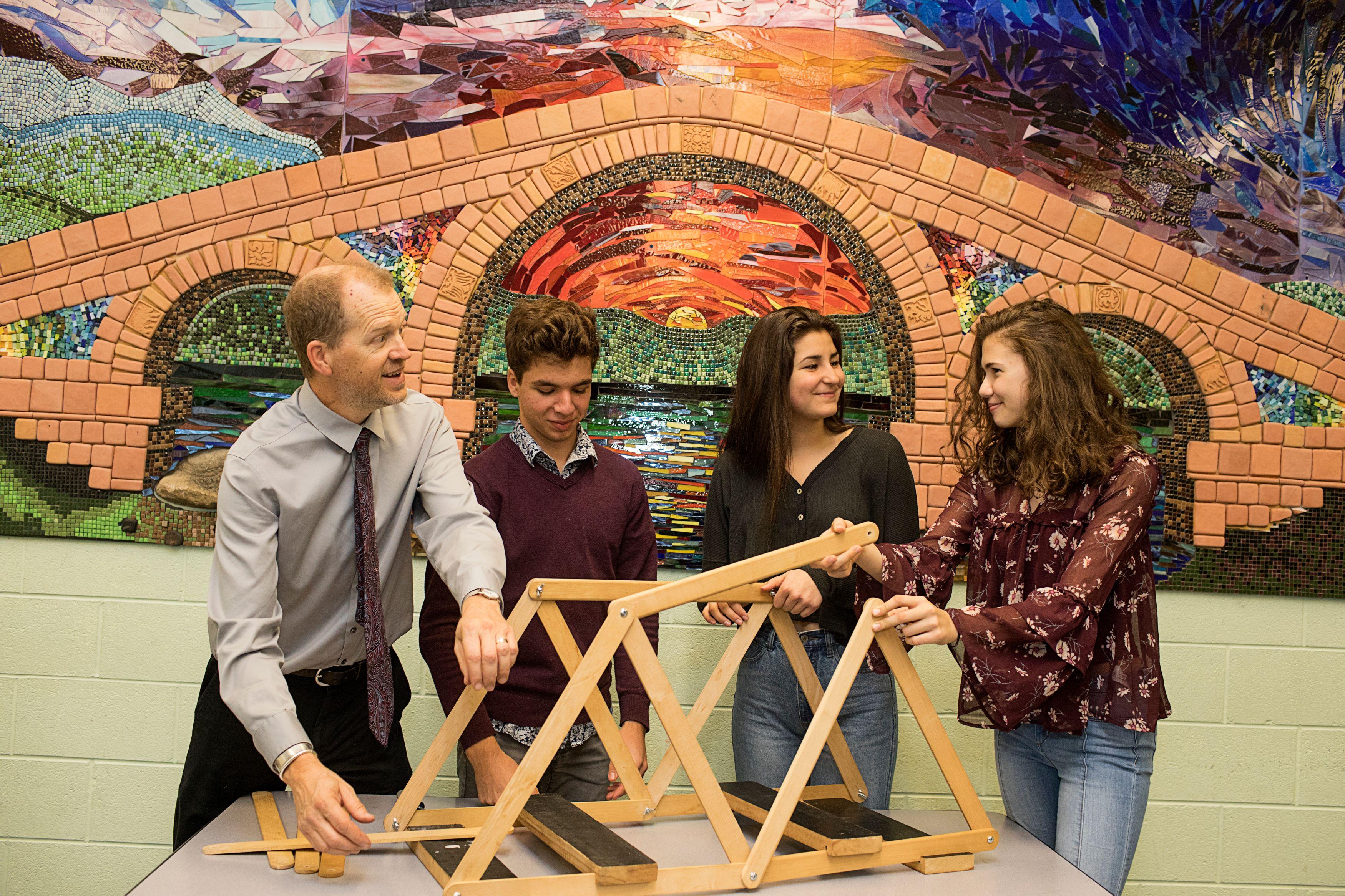 Students and teacher with physics bridge