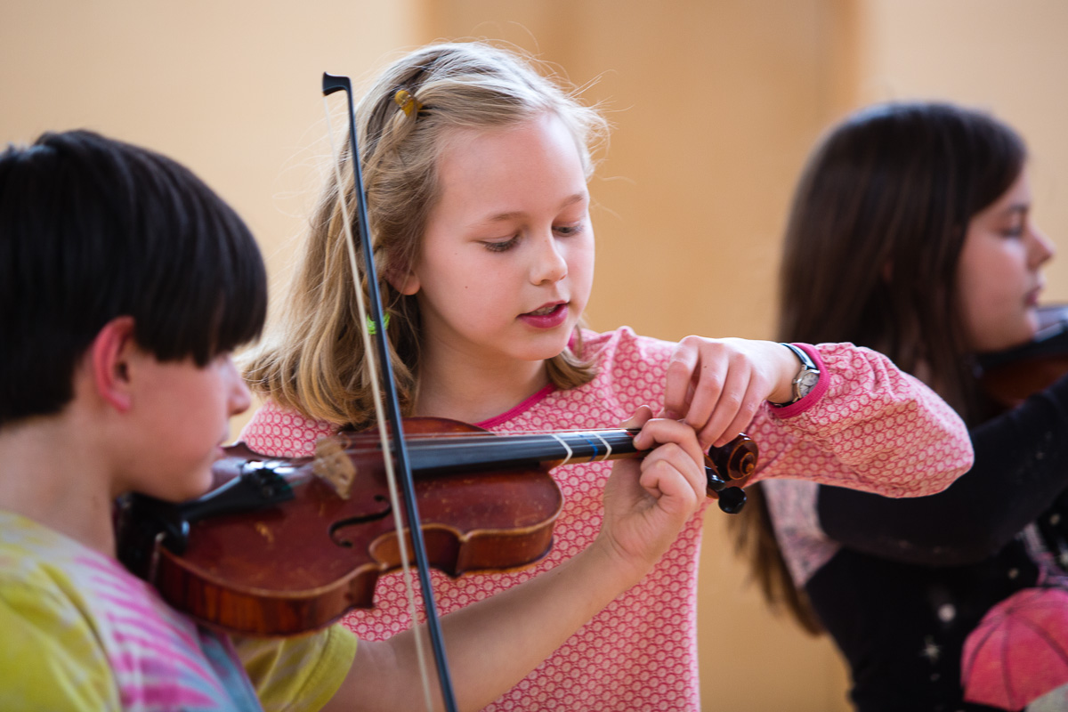Student helping Tune Violin