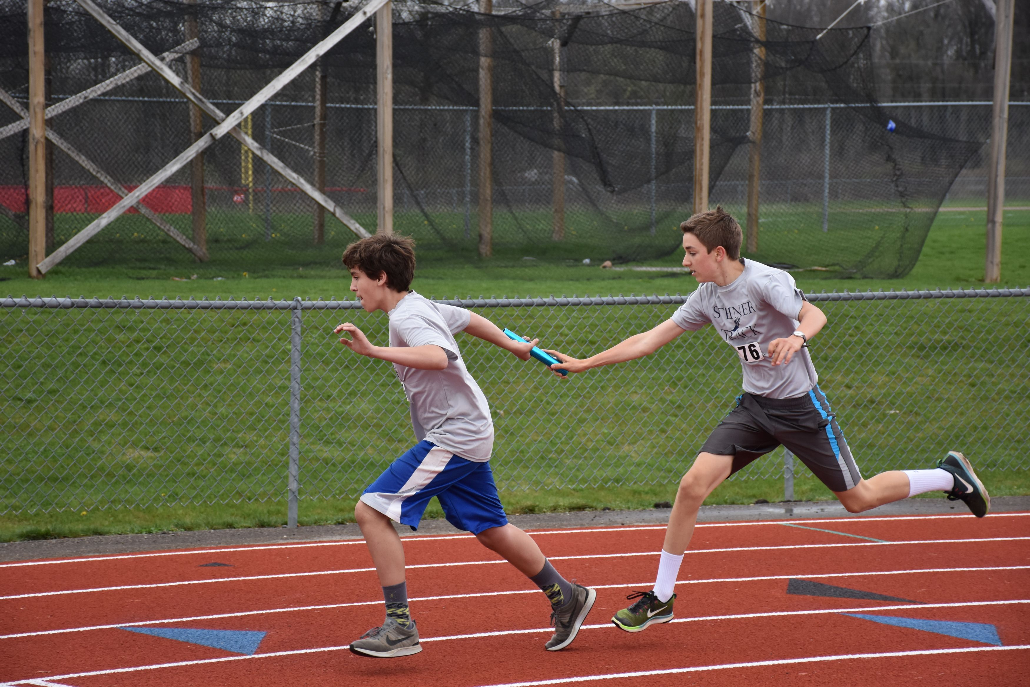 Two Boys Running Relay Race