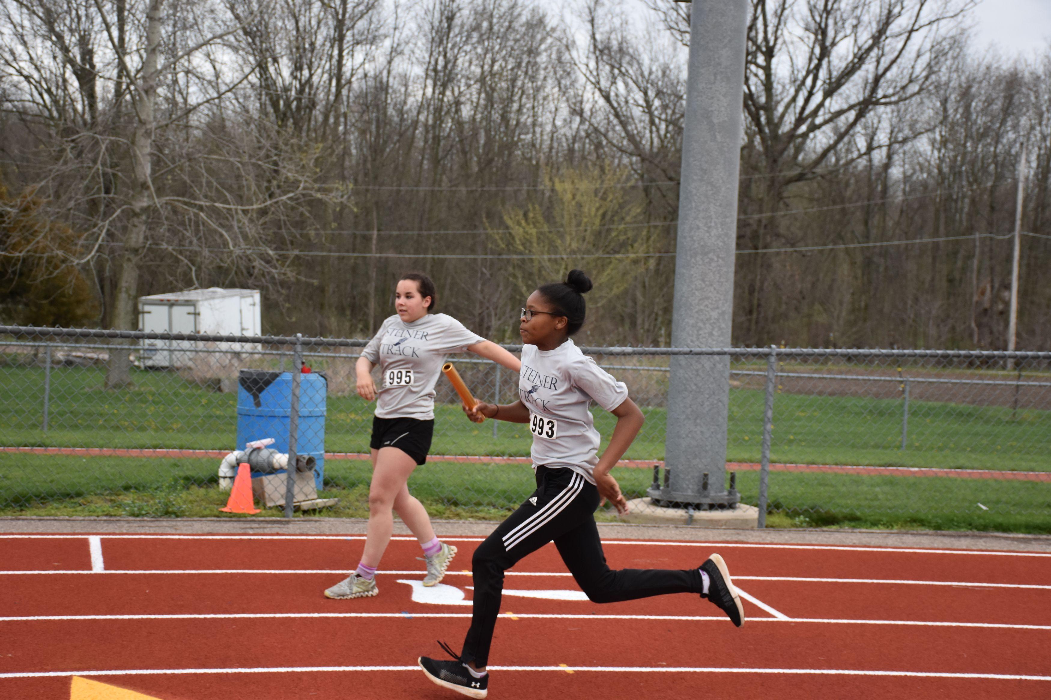 Students running track