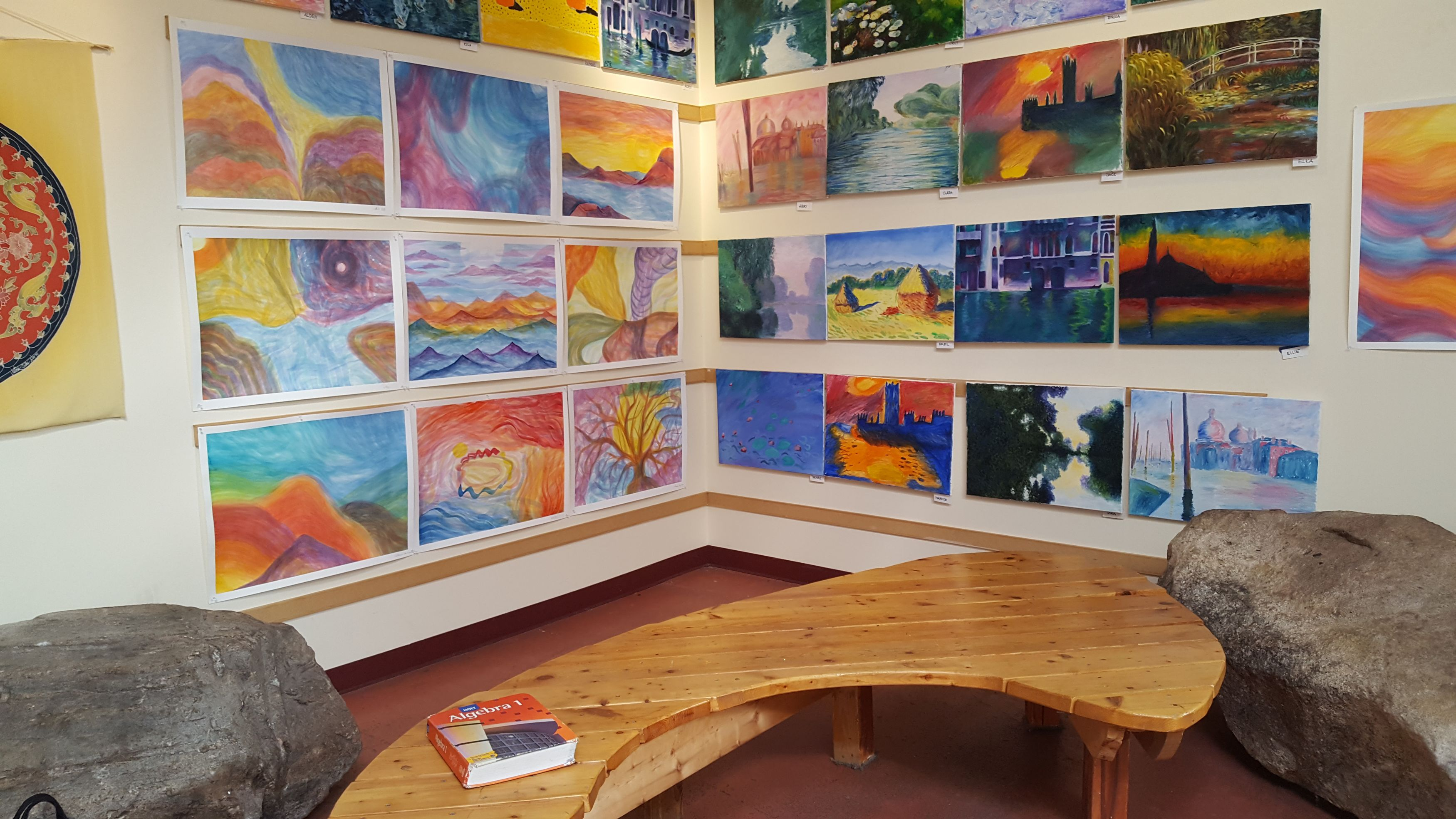 School hallway with bench and artwork