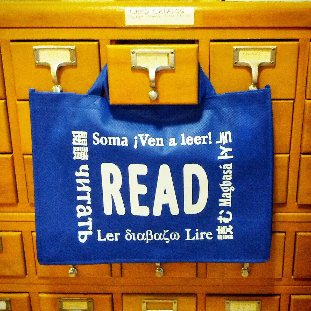 "Blue Bag with ""Read"" Hanging from Card Catalog"