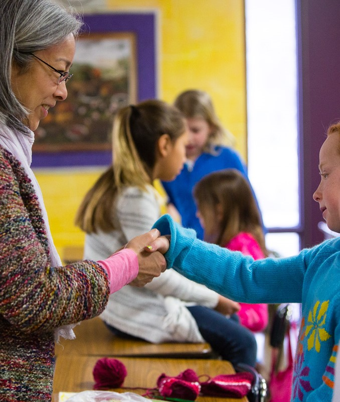 Teacher and student shaking hands